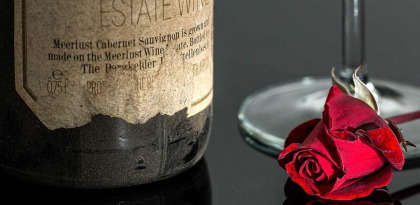 Wine and red rose
